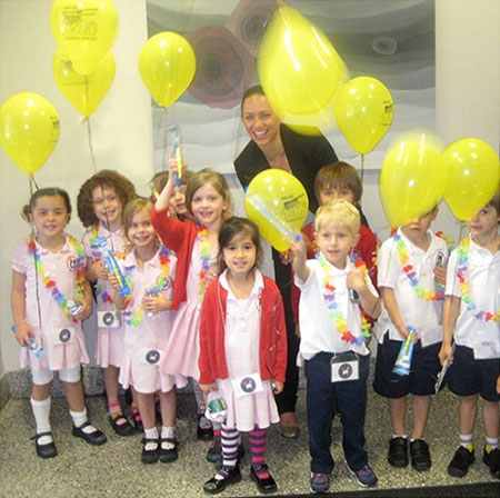 Twinkle Dentist staff with children and balloons serving New York